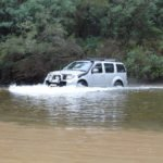 4WD with snorkel moving through river