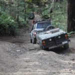 4WD and trailer on rough 4x4 track