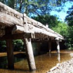 Old wooden bridge over river