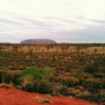 Australian outback with Uluru in the distance
