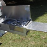 A hard floor camper showing fold-out kitchen