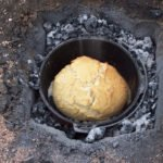 Damper cooking in campfire